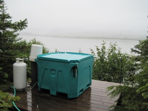 a fish tote transformed into a hot tub, you can't really tell but the glacier is directly across from this.