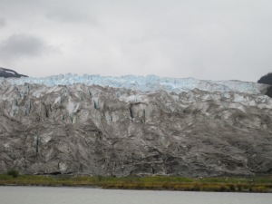 riding boat right in front of glacier